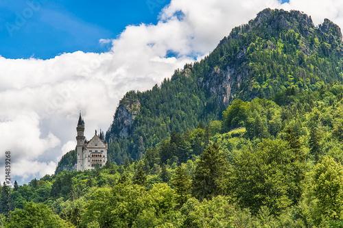 Schwangau, Germany June 10, 2018: Famous Neuschwanstein Castle with scenic mountain landscape near