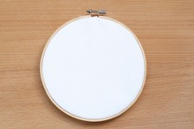 Round Wooden Hoop With A White Cloth.