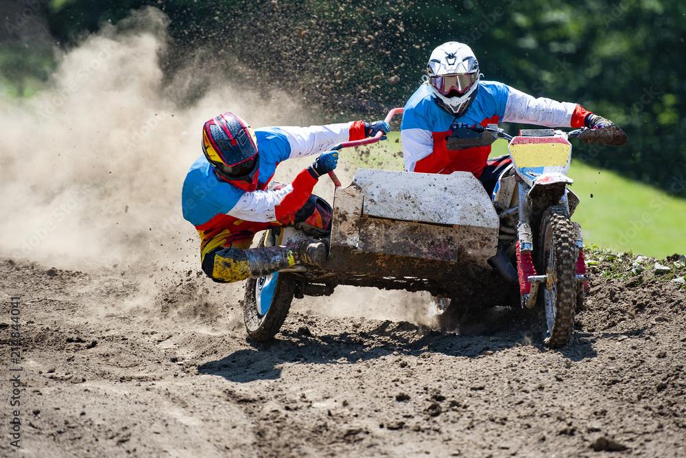 Fototapeta Sidecar during the passage on the motocross track