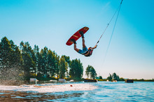 Young Man Wakeboarding On A La...