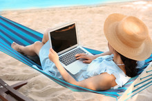 Young Woman With Laptop Restin...