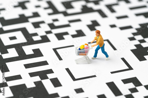 Miniature people figurine, a man with grocery in the shopping cart at the center Canvas-taulu