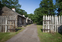 Pioneer Log Cabin. Row Of Log Cabins At Fort Wilkins State Park In Copper Harbor, Upper Peninsula, Michigan, USA.