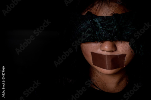 Fényképezés  Woman was wrapping her mouth by adhesive tape and close eyes with a scarf, Concept freedom of speech, censorship, freedom of press, women trafficking