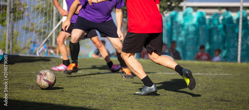 Football soccer players playing in a football field on a sunny day, banner Canvas Print