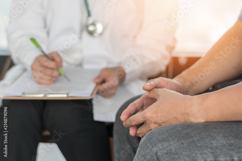 Male Patient Having Consultation With Doctor Or Psychiatrist Who