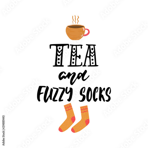 Photo  Tea and fuzzy socks - hand drawn cozy Autumn or Winter seasons holiday lettering phrase and Hugge doodles cup and warm socks isolated on background
