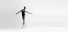Graceful Ballerina Dancing In ...