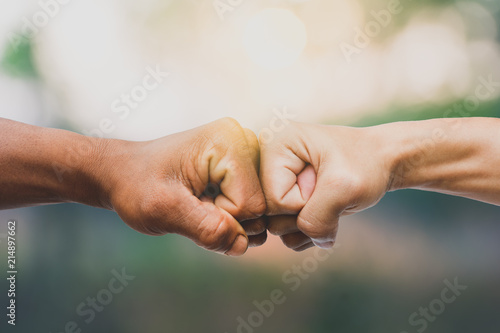 Man giving fist bump in nature background Fototapet