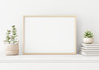canvas print picture Home interior poster mock up with horizontal metal frame, succulents in basket and pile of books on white wall background. 3D rendering.