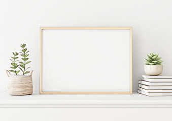 Home interior poster mock up with horizontal metal frame, succulents in basket and pile of books on white wall background. 3D rendering.