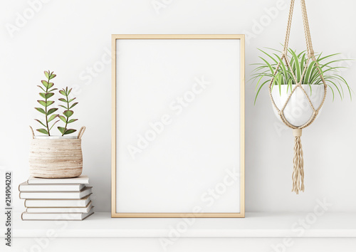 Fotografie, Obraz  Home interior poster mock up with horizontal metal frame, succulents in basket and pile of books on white wall background