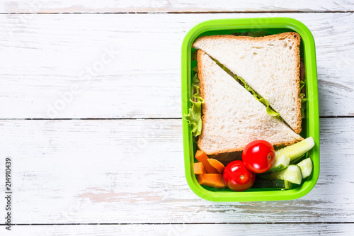 In de dag Assortiment Lunch box with sandwich and vegetables.