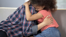 Caring Adult Lady Hugging Litt...