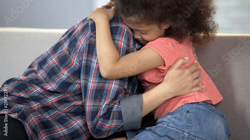 Photo Caring adult lady hugging little girl, child adoption system, family happiness
