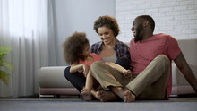 Multiracial Family Sitting Together And Laughing, Spending Nice Time Together