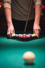 Man Arranging Snooker Balls In Triangle Rack