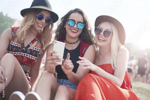 Happy friends making selfie at music festival