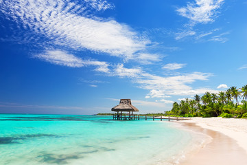 Beautiful gazebo on the tropical white sandy beach