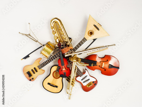 musical instruments. Mini models, toys, souvenirs on a light background. - 214934208