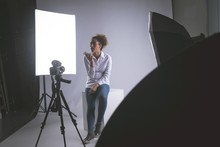 Female Photographer Talking On Mobile Phone