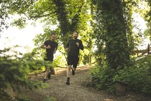 Two Mens Jogging Together At Boot Camp