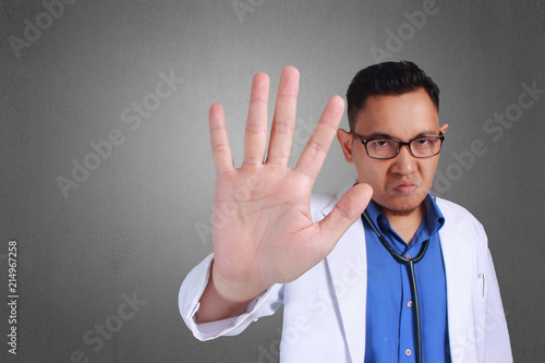 Doctor Making Stop Sign Tablou Canvas