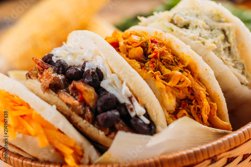 Combination of the typical South American Arepas in a woven basket