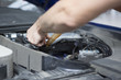 People are repair a car Use a wrench and a screwdriver to work.Safe and confident in driving