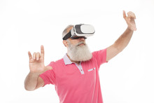 Senior Man Using VR Goggles