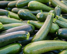 Stacks Of Green Zucchini At Th...