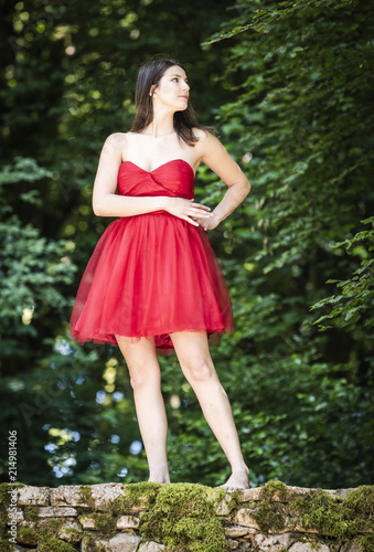 709bd33285b belle femme en robe rouge en foret - Buy this stock photo and ...