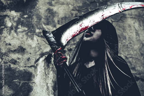 Witch licking blood on reaper Canvas Print