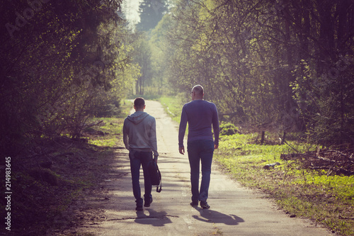 Two friends on walk, big and small concept