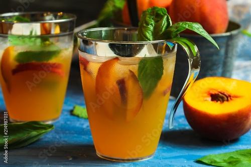 Valokuva  Homemade Peach Basil Cocktail drink / Sangria, selective focus