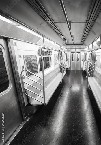 Black and white picture of a New York City subway car interior, USA.