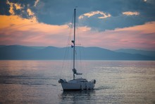 Sailing Boat With A Beautiful Sunset In The Background