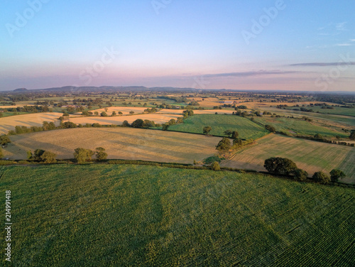 Obraz na plátně Aerial view on cheshire plains and fields. Summer sunset behind