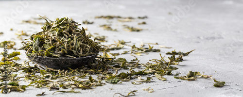 Fotografie, Obraz Loose dried white tea leaves on grey background