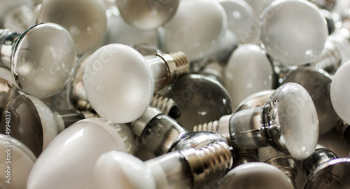 Fototapeta  Disposal of used energy saving lamps, old spent bulbs.