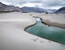Sand Dunes Of Nubra Valley. Himalaya Mountains Landscape