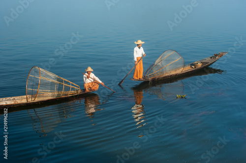 Burmese fisherman on bamboo boat catching fish. Myanmar Poster Mural XXL