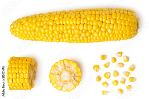 Vászonkép The peeled ear of corn, a piece of and seeds on a white, isolated