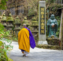 A Buddhist Monk Walking At Jap...
