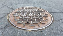 Sewer Metal Cap On The Road In...