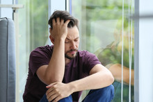 Lonely Depressed Man Near Wind...