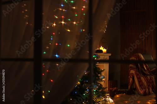 Stylish Living Room Interior With Christmas Lights At Night View