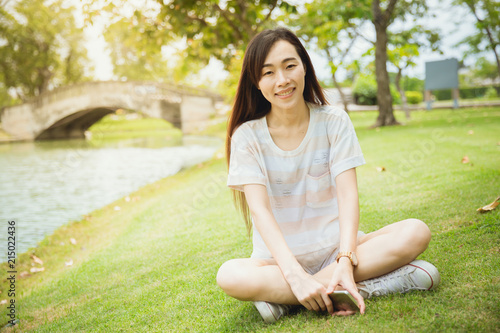 Valokuva  Asian teen chinese race single eyelid long hair sitting smile with dimples cheek