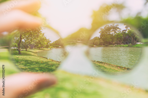 see looking through glasses lens vision from blurry to clear park view Wallpaper Mural