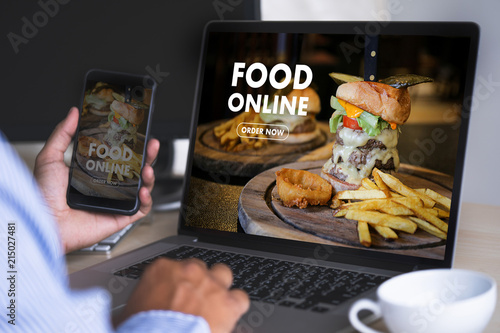 Foto Close up woman ordering food online  by internet  Concept order food
